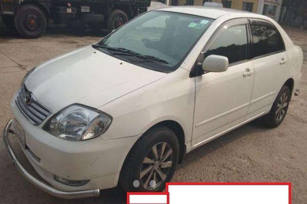 Toyota Corolla 2003 White Color Registration 2009